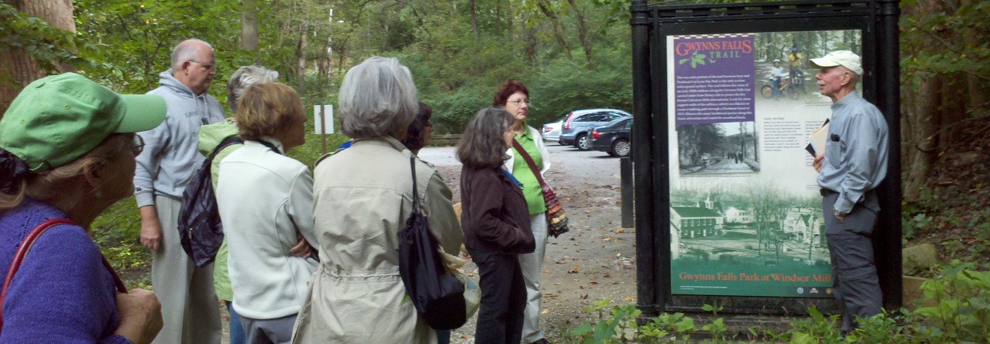 Ed Orser leading a tour of the Gwynns Falls Trail for students in the Johns Hopkins University Odyssey course on the Olmsted Legacy in Baltimore, offered by FMOPL this year.