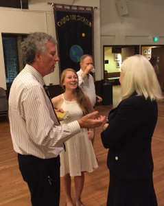 Freshly-elected Board President Mark Cameron and Secretary Katie Dix chat with Lisa Schroeder at the reception.